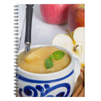 Applesauce with cinnamon in stoneware bowl notebook
