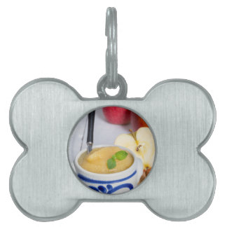Applesauce with cinnamon in stoneware bowl pet ID tags