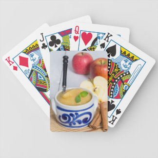 Applesauce with cinnamon in stoneware bowl poker deck