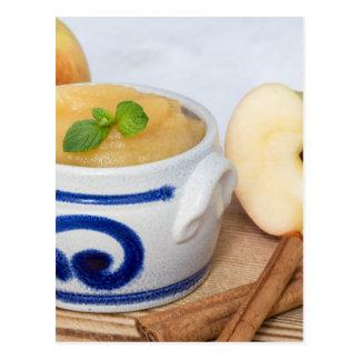 Applesauce with cinnamon in stoneware bowl postcard