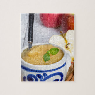 Applesauce with cinnamon in stoneware bowl puzzle