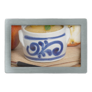 Applesauce with cinnamon in stoneware bowl rectangular belt buckles