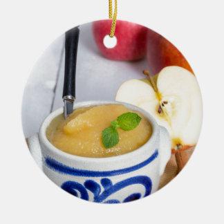 Applesauce with cinnamon in stoneware bowl round ceramic decoration