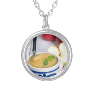 Applesauce with cinnamon in stoneware bowl round pendant necklace