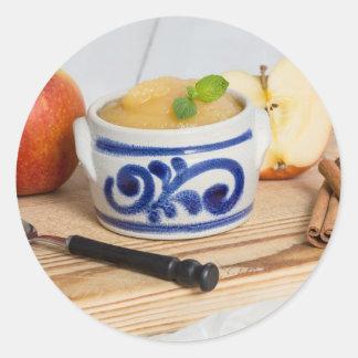 Applesauce with cinnamon in stoneware bowl round sticker