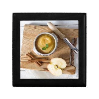 Applesauce with cinnamon in stoneware bowl small square gift box