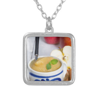 Applesauce with cinnamon in stoneware bowl square pendant necklace