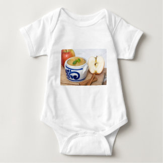 Applesauce with cinnamon in stoneware bowl t shirts