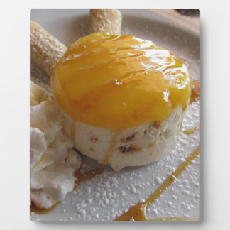 Apricot jam covered ice cream cake plaque