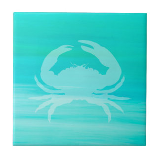Aquamarine sea water with a crab tile