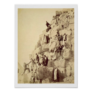 Arabs assisting tourists to climb the pyramids at poster