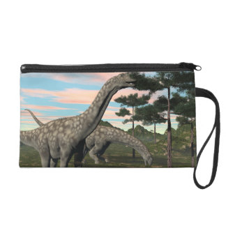 Argentinosaurus dinosaur eating tree - 3D render Wristlet Clutch