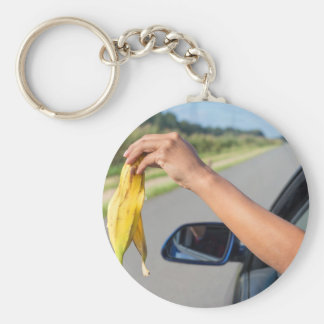 Arm dropping peel of banana out car window basic round button key ring