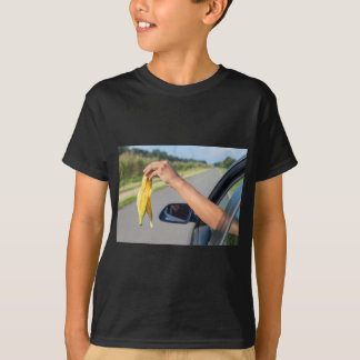 Arm dropping peel of banana out car window T-Shirt