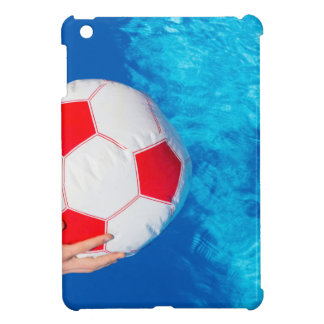 Arms holding beach ball above swimming pool water iPad mini cover
