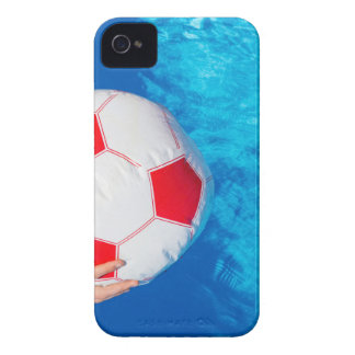 Arms holding beach ball above swimming pool water iPhone 4 covers