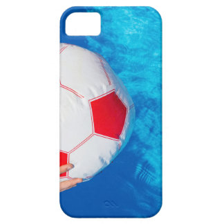 Arms holding beach ball above swimming pool water iPhone 5 covers