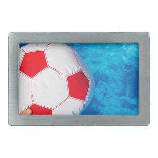 Arms holding beach ball above swimming pool water rectangular belt buckles