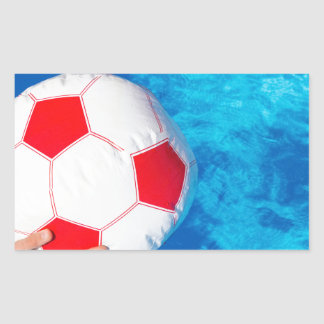 Arms holding beach ball above swimming pool water rectangular sticker