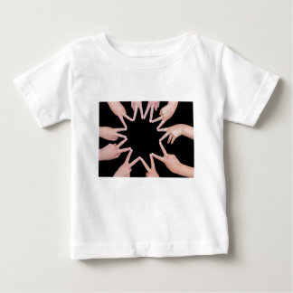 Arms of girls  hands making ten pointed star baby T-Shirt