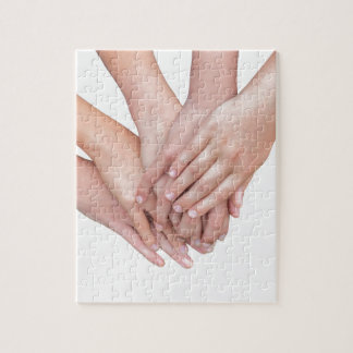 Arms of girls hands on each other jigsaw puzzle