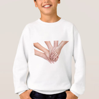 Arms of girls hands on each other sweatshirt