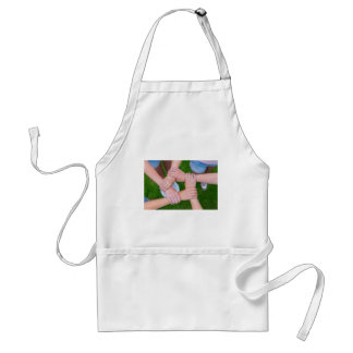 Arms with hands of children holding together standard apron