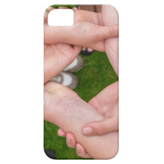Arms with hands of girls holding each other iPhone 5 cover