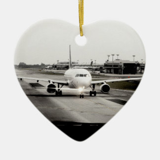 Arplane on runway for take off ceramic heart decoration