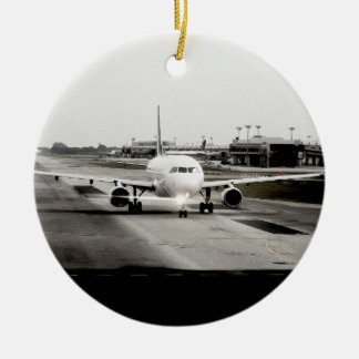 Arplane on runway for take off round ceramic decoration