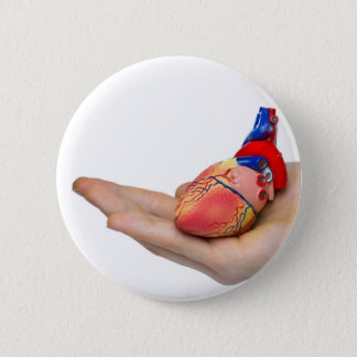 Artificial human heart model on hand 6 cm round badge