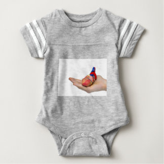 Artificial human heart model on hand baby bodysuit