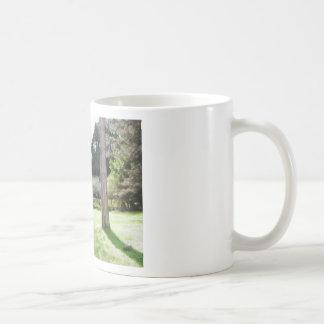 Artistic representation of tuscan countryside coffee mug