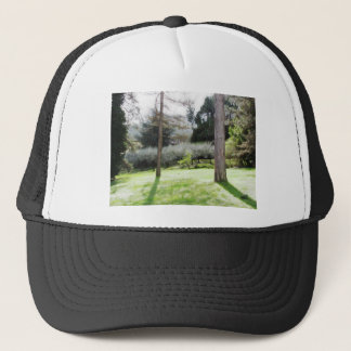 Artistic representation of tuscan countryside trucker hat