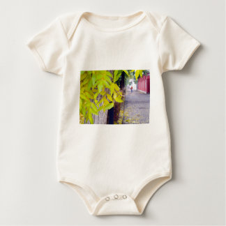 Ash tree with yellow leaves and pavement tiles baby bodysuit