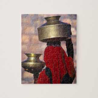 Asia, India, Rajasthan. A local woman in a red Puzzles