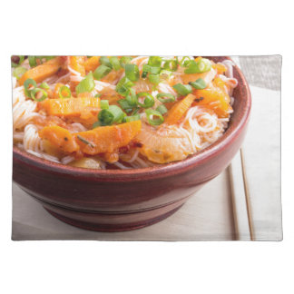 Asian food of rice noodles in a small wooden bowl placemats