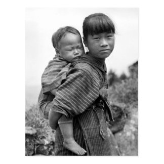 Asian girl carrying child on her back (1908) postcard