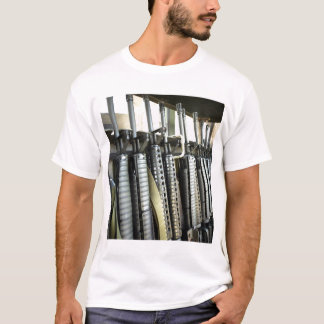 Assault rifles stand ready on the weapons rack T-Shirt
