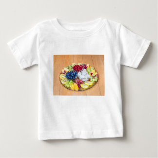 Assortment fresh summer fruit on glass scale baby T-Shirt