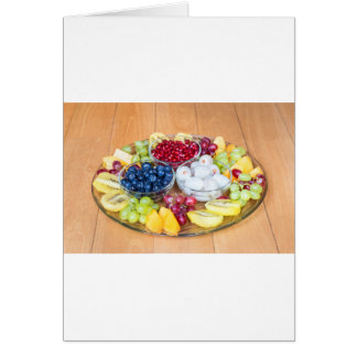 Assortment fresh summer fruit on glass scale card
