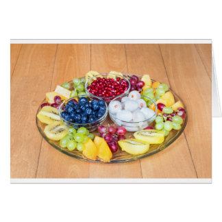 Assortment fresh summer fruit on glass scale card