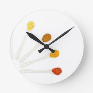 Assortment seasoning spices on porcelain spoons wall clock
