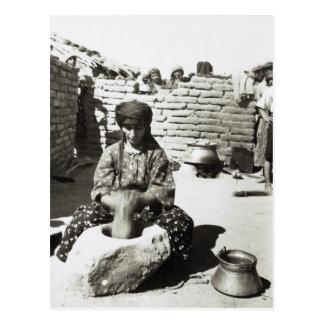 Assyrian refugee pounding bulgur in mortar postcard