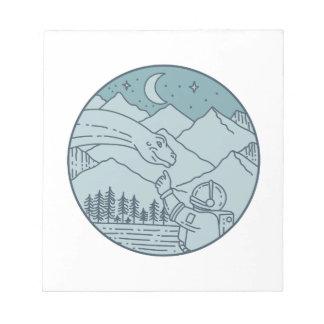 Astronaut Brontosaurus Moon Stars Mountains Circle Notepad