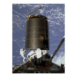 Astronauts capture and repair INTELSAT VI (STS-49) Poster