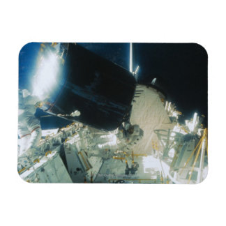 Astronauts Repairing a Satellite in Space Magnets
