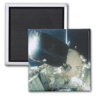 Astronauts Repairing a Satellite in Space Square Magnet