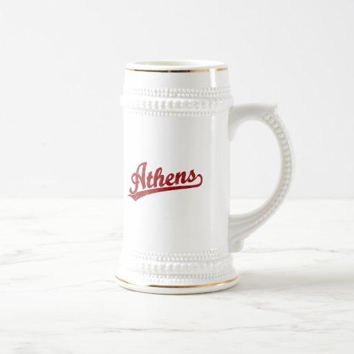 Athens script logo in red mugs