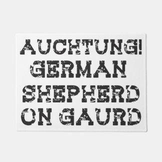 Auchtung! German Shepherd on Guard door mat